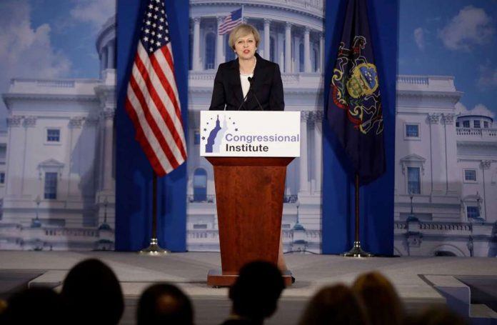 British PM May Praises Trump, But Has Strong Words Too