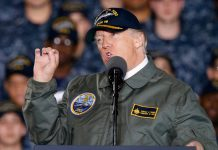 Trump Aboard Navy Carrier Vows to Boost Defense Spending