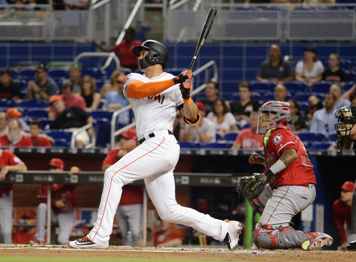 feee6658 Stanton's Long Homer Helps Marlins Beat Angels 8-5 Miami Marlins' Giancarlo  Stanton, left, watches after hitting a two-run home ...