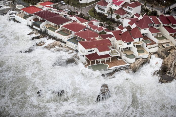 Powerful Hurricanes to Fuel Climate Talks