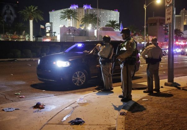 A wounded person is walked in on a wheelbarrow as Las Vegas police respond during an active shooter situation on the Las Vegas Stirp in Las Vegas Sunday, Oct. 1, 2017. Multiple victims were being transported to hospitals after a shooting late Sunday at a music festival on the Las Vegas Strip. (Chase Stevens/Las Vegas Review-Journal via AP)