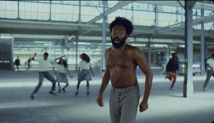 "Childish Gambino's ""This is America"" Video Tackles Racism, Gun Violence"