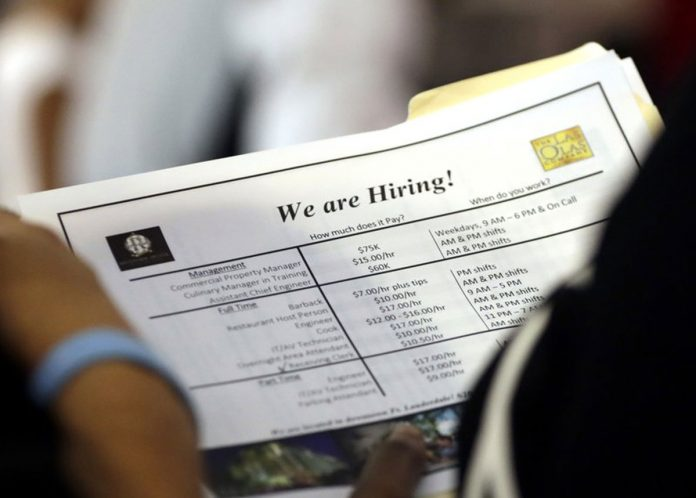 US Employers Add 157,000 Jobs, Jobless Rate Hits 3.9 pct.