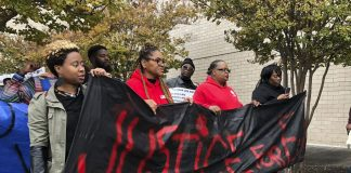 Protesters march for man killed at Alabama mall