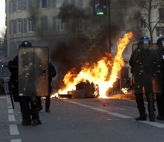 Paris Under Siege: Tear Gas, Fury on the Champs-Elysees