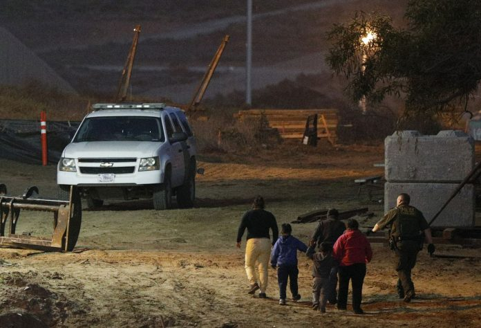 Asylum Seekers to Wait in Mexico