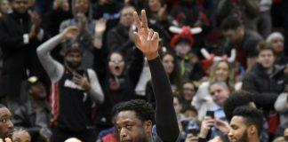 Wade helps Heat beat Bulls 117-103