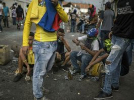Venezuela Standoff Turns Deadly as Troops Block Aid Delivery
