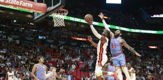 Wade scores 14 in 4th to help Heat stave off Hawks, 114-113