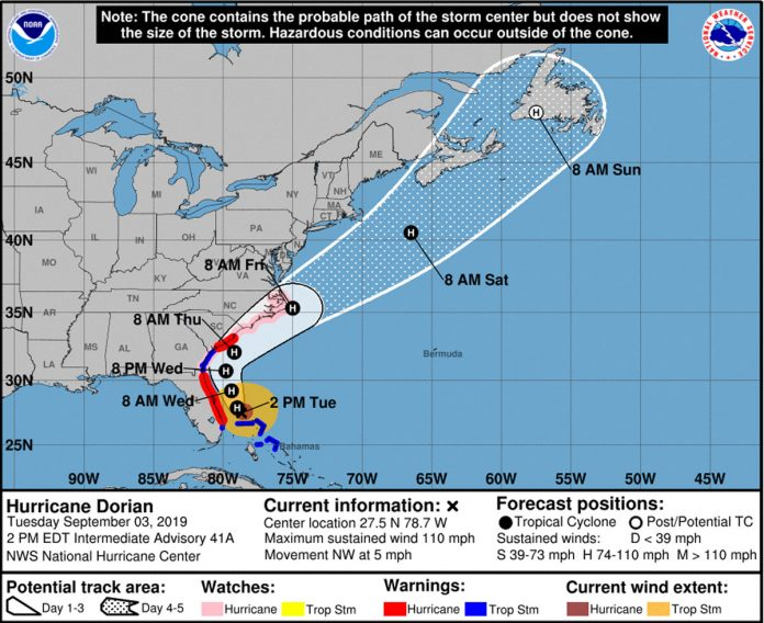 Dorian Weakens to a Category 2 Storm, but is 'Growing in Size'