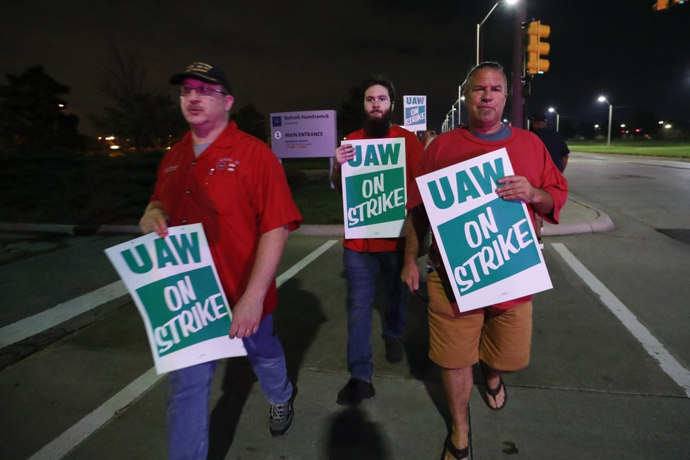 United Auto Workers members picket outside the General Motors Detroit-Hamtramck assembly plant in Hamtramck