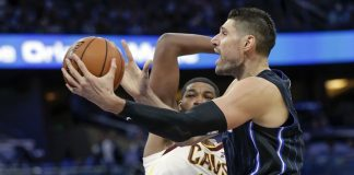 Magic, Vucevic beat Cavaliers in season opener
