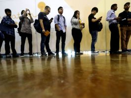 US adds modest 136,000 jobs, lowering unemployment to 3.5%