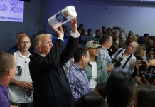 Democrats unveil billboard of Trump tossing paper towels