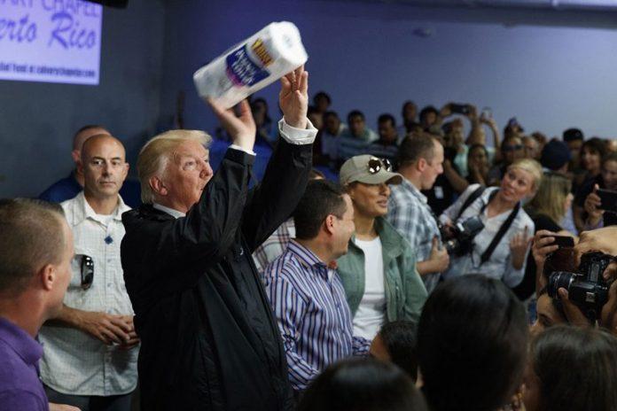 Democrats unveil billboard of Trump tossing paper towels